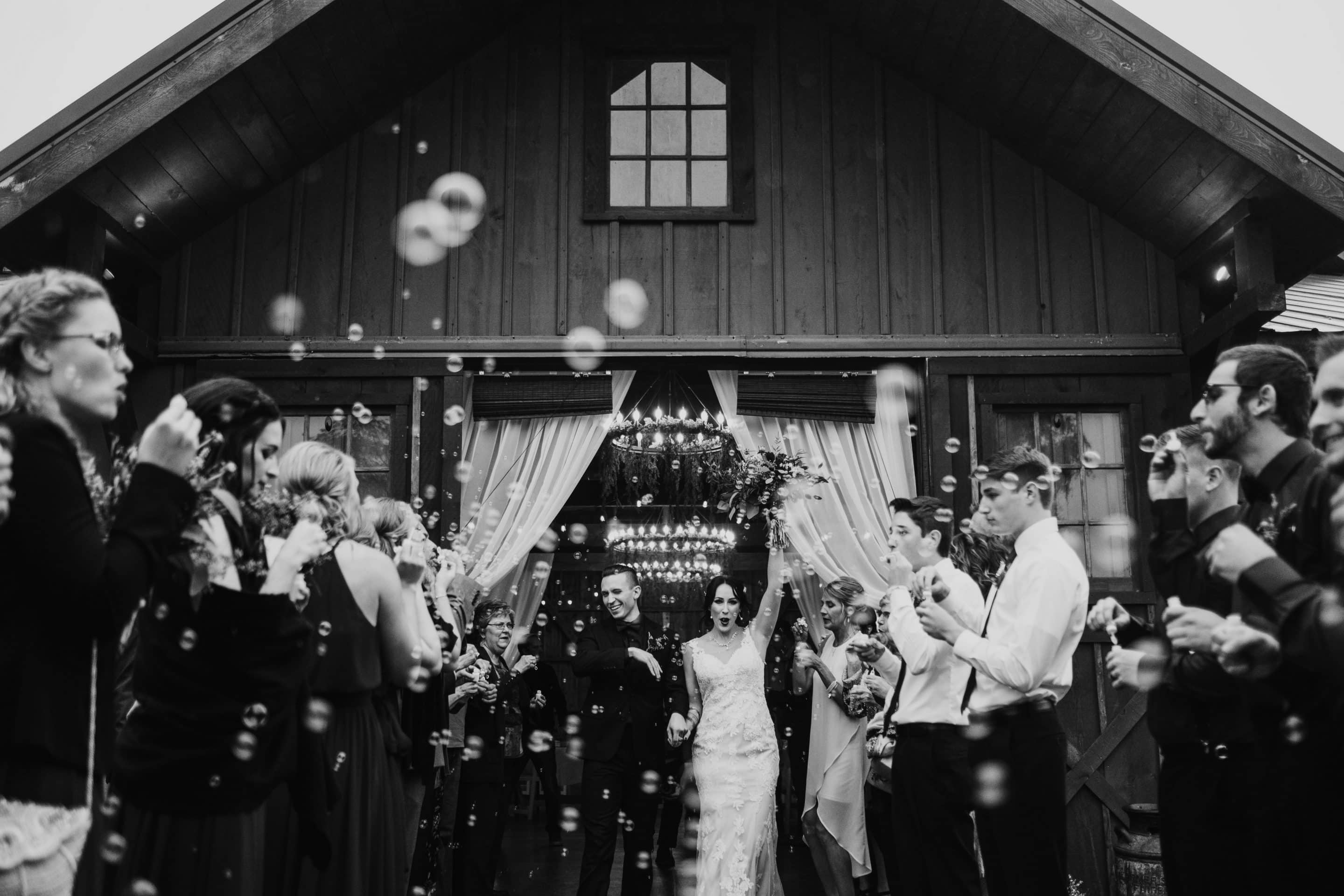 Intrepid Visuals Wedding Photography Lincoln Nebraska Wedding Photographer Bubble Exit Creekside Event Barn