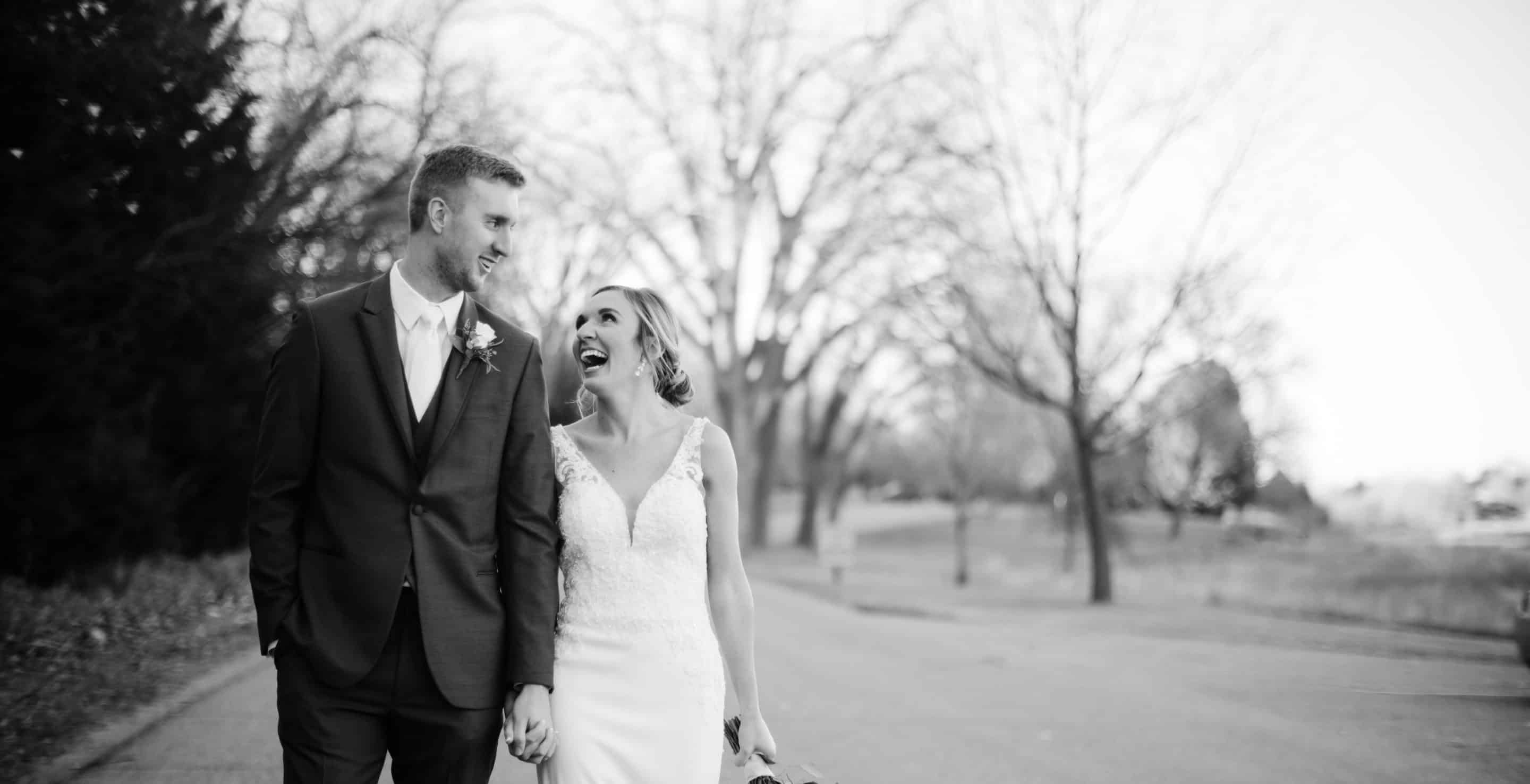 Newly married couple laughing together after their wedding Lincoln Nebraska Wedding Photographer